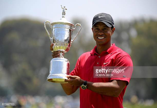 Woods digs deep, edges Mediate in playoff to win Open