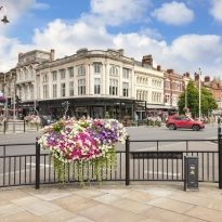 2 July 2019: Southport, Merseyside - A view of Lord Street, the main shopping street, and Bistro Pierre.